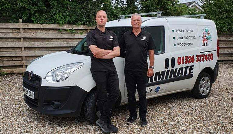 Bill & Craig from Terminate Pest Control stood by their van