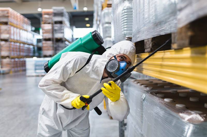 pest controller in suit